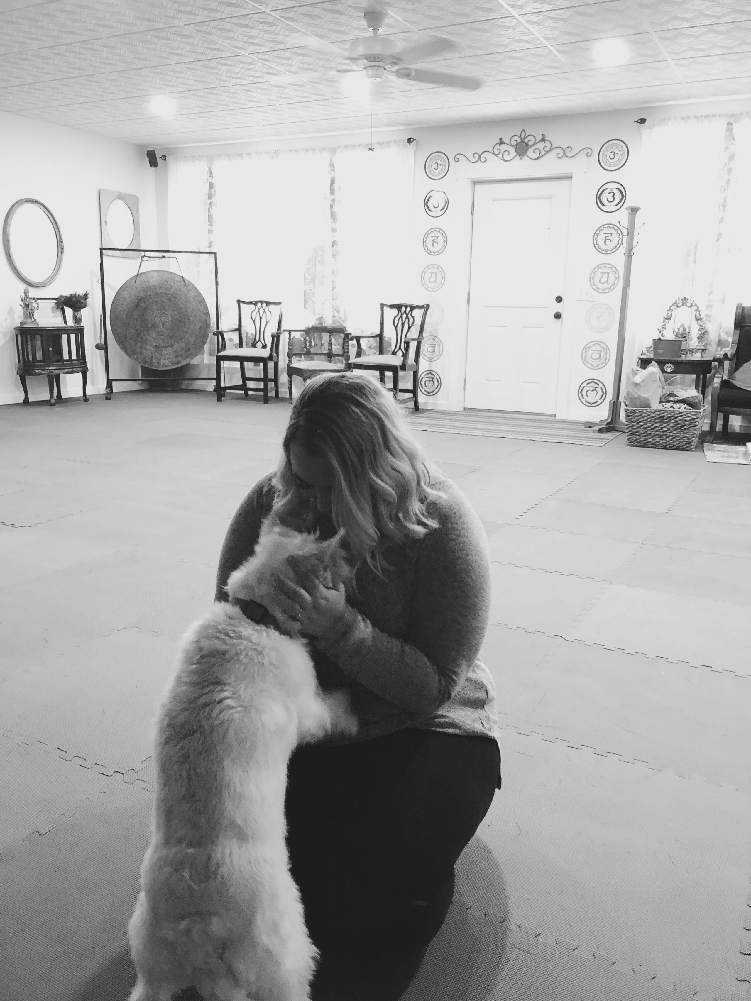 Ashley Price snuggling the dog, Bhakti